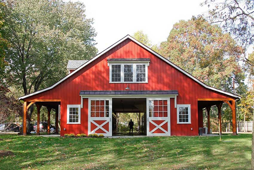 Metal siding panels installed over block walls rot for Red metal barn