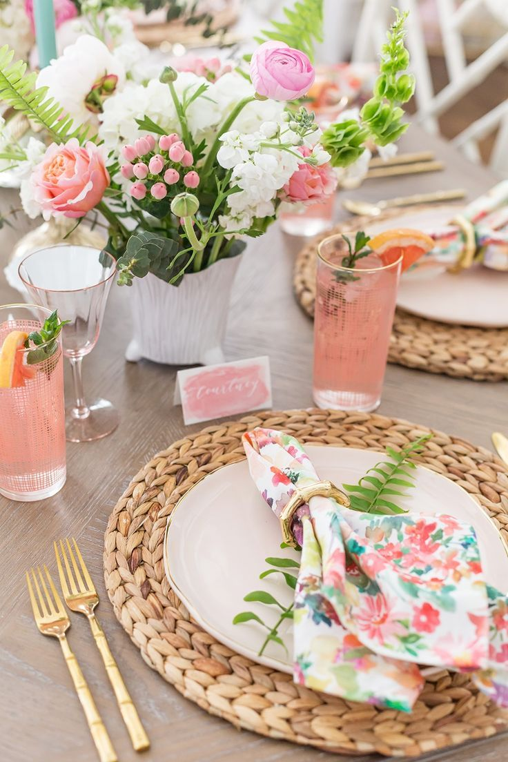 This lovely floral table setting is perfect for a spring or summer party outdoors.