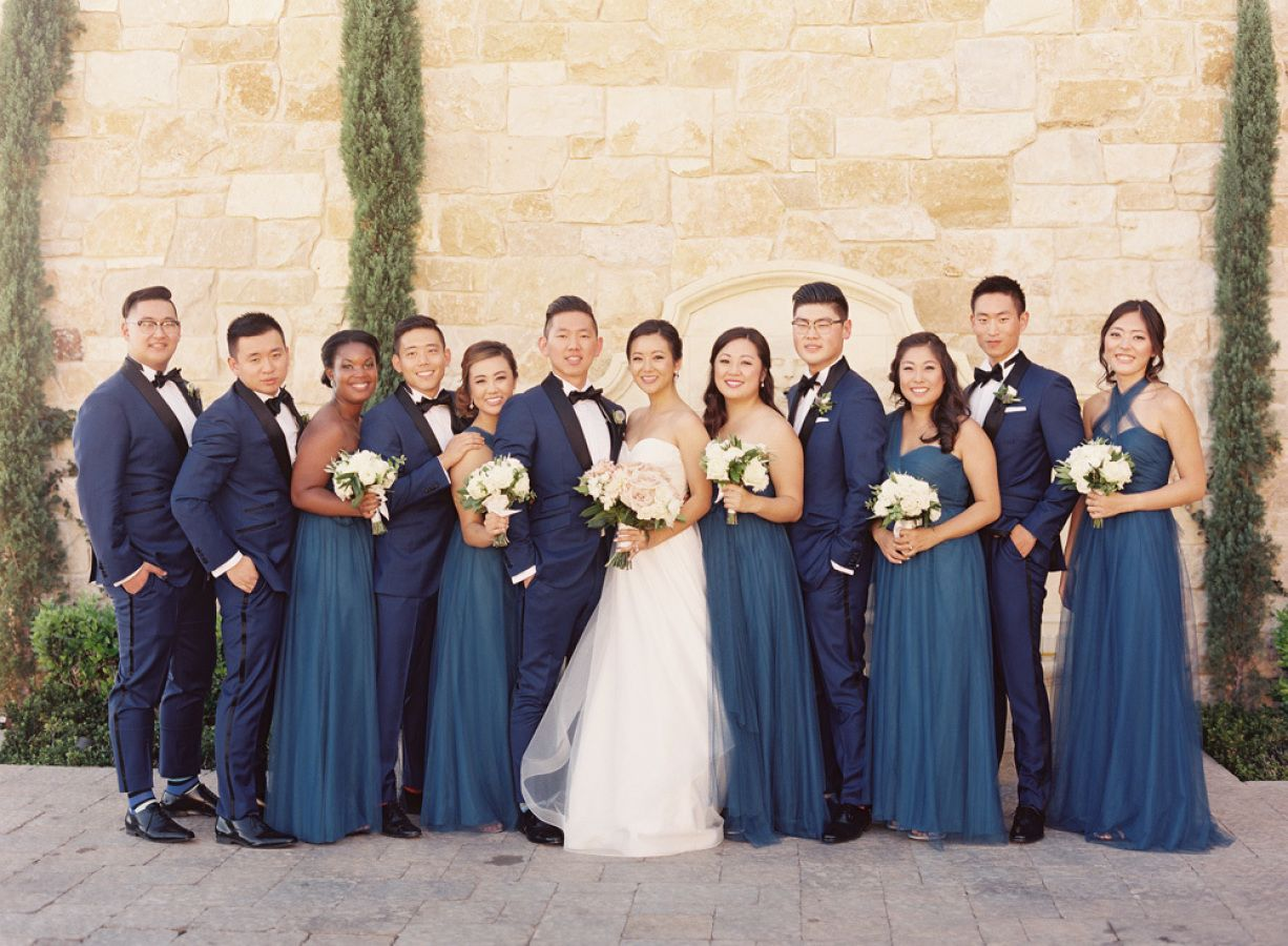 Blue bridesmaids with white bouquets