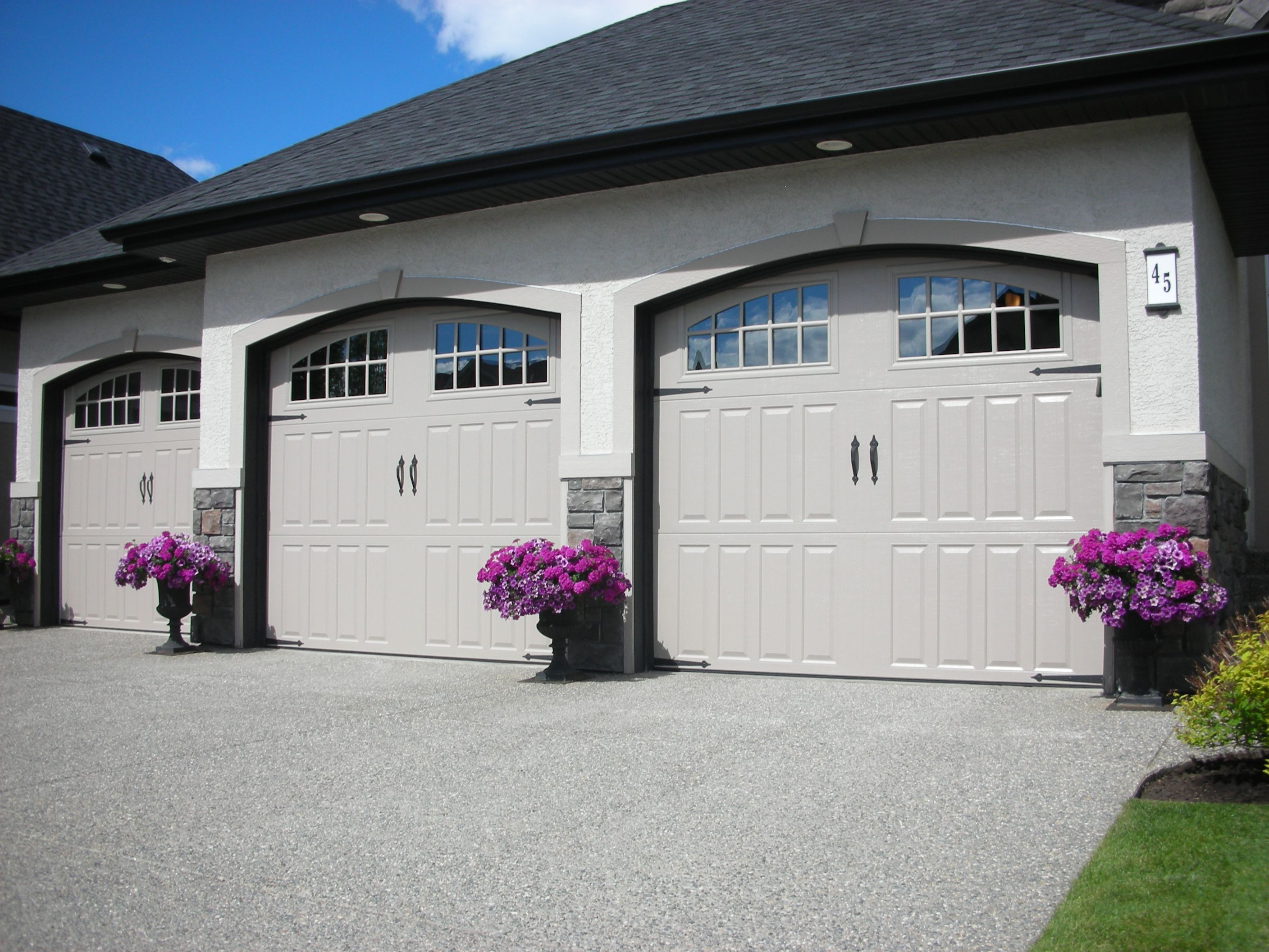 Amarr classica northampton garage door in true white with thames amarr classica northampton garage door in true white with thames windows and optional blue ridge handles and straps visit amarr for more rubansaba