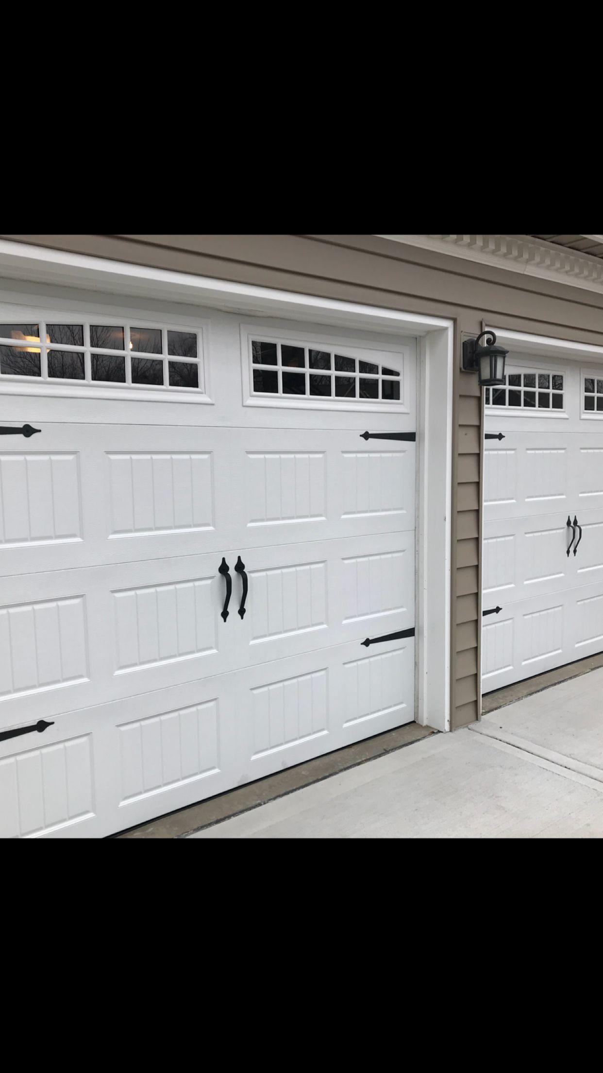Beautiful White Carriage Style Garage Door With Decorative Hardware And Moonlite Long Panel Wind Garage Doors Carriage Style Garage Doors Carriage Garage Doors