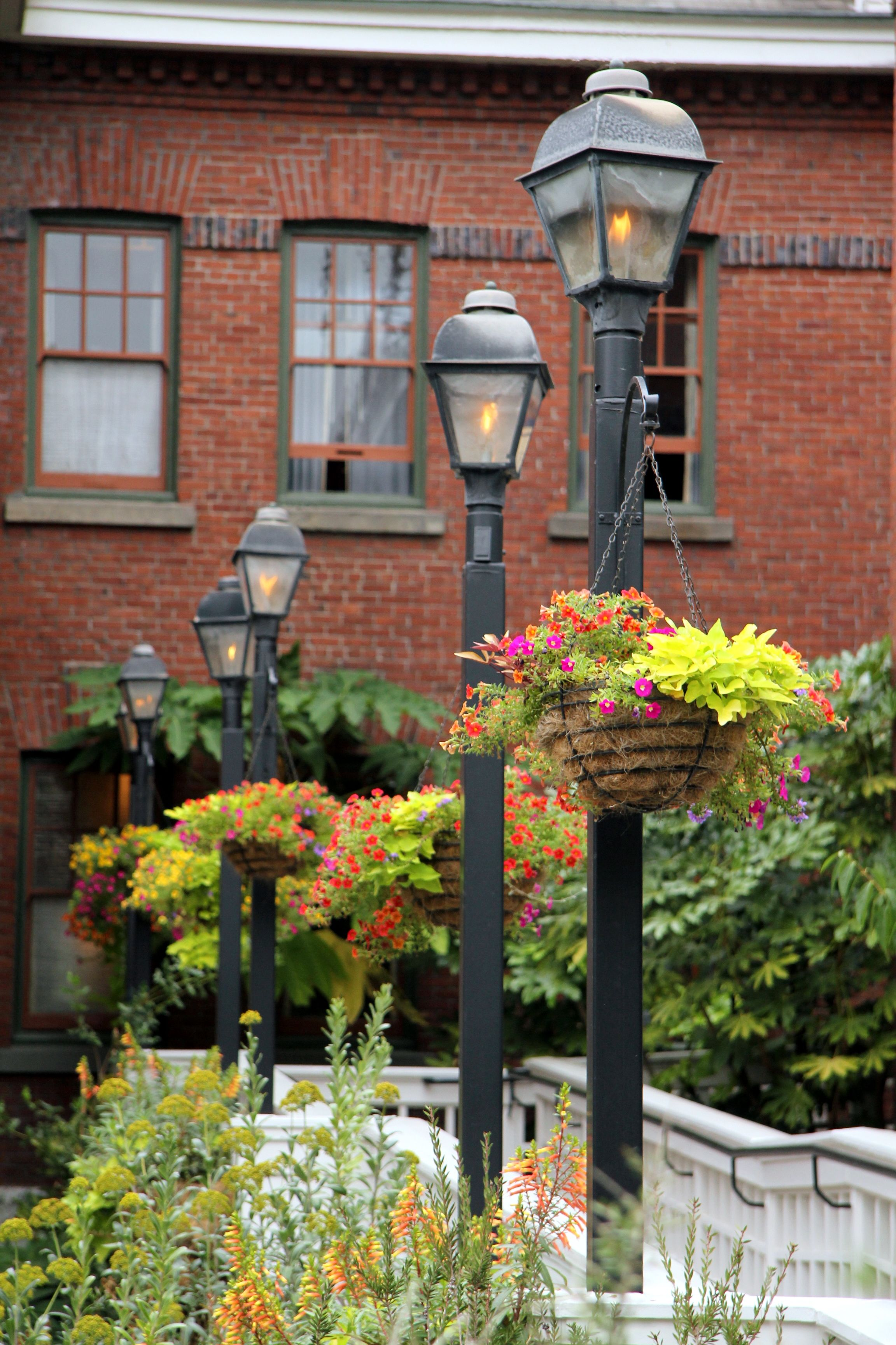 Lamp Posts with hanging baskets... oh yes!