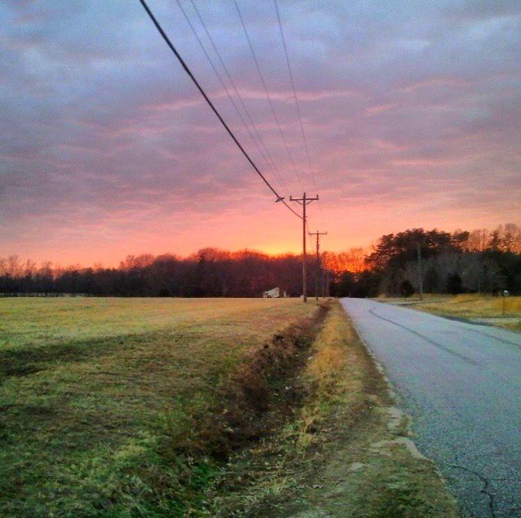 Sunset beside farm.