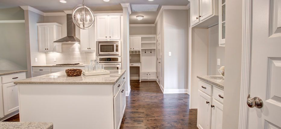 Cabinets and Island with very clean look. A white kitchen ...