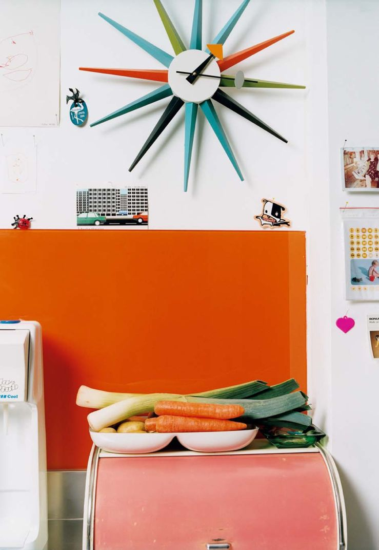 This retro clock adds a pop of color to any room in the house! We have it on sale now! #color