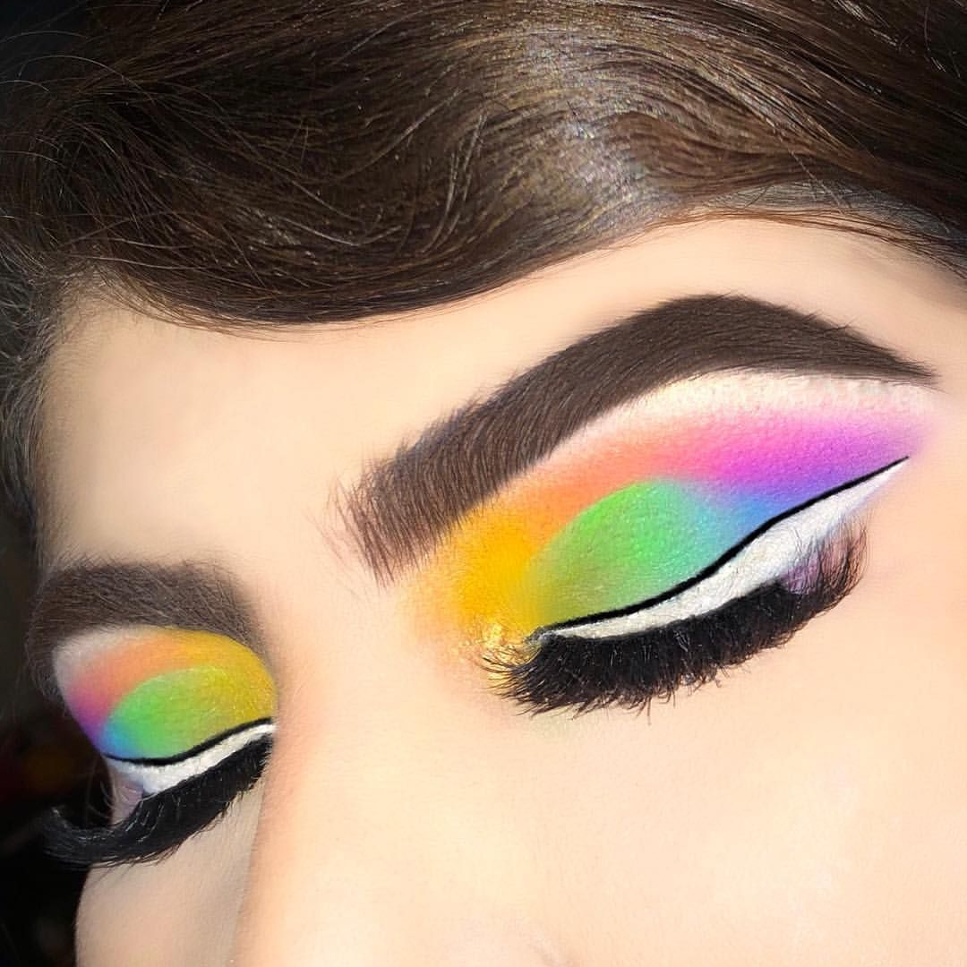 Pastel rainbow eyeshadow. White eyeliner. Yellow, orange