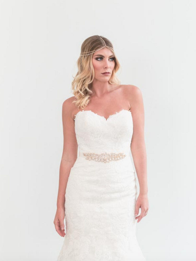 db8ec89d459c6 STELLA YORK // ONE & ONLY BRIDAL BOUTIQUE // This fitted wedding dress is  for a bride who loves lace & a classic shape. We added a beaded belt to add  ...