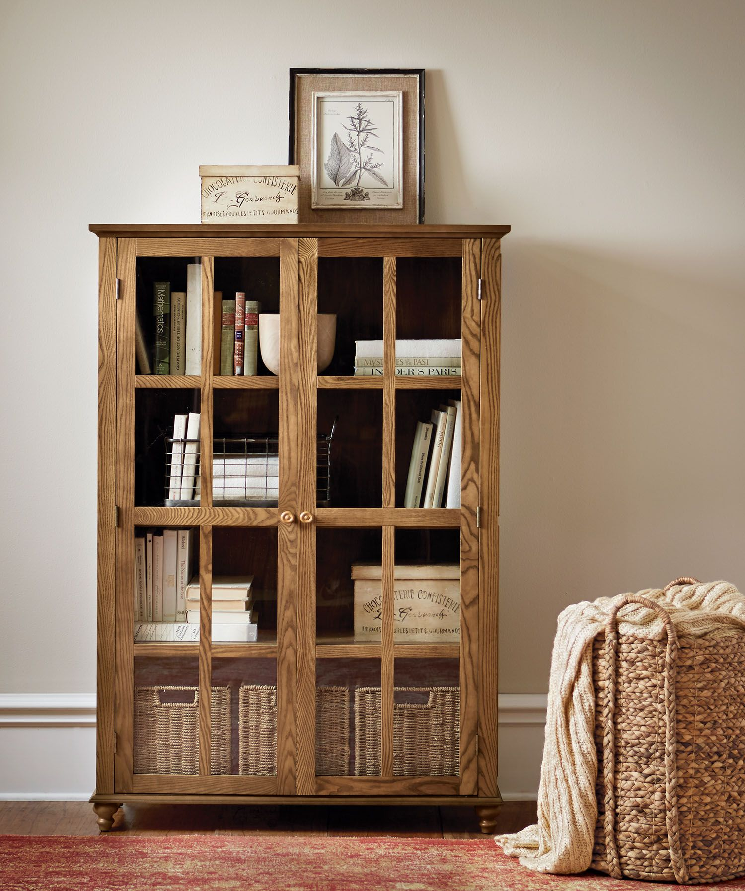 A Glass Door Bookcase To Store Books Files And More