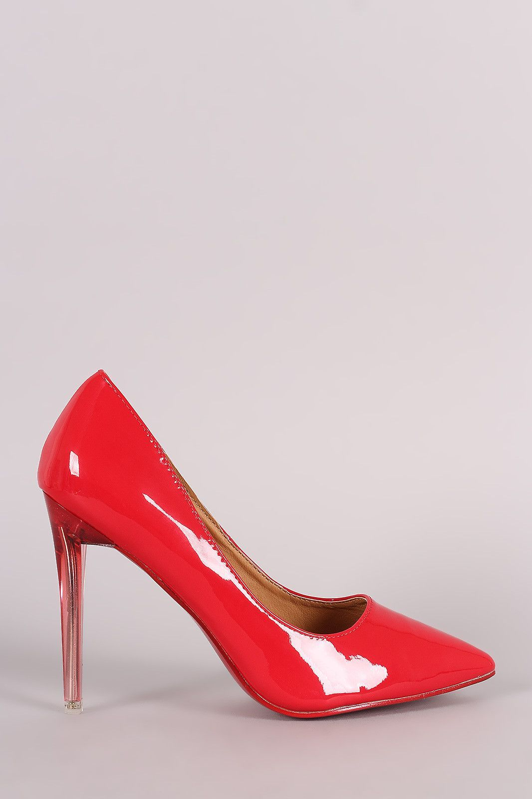 """This alluring  pump  features a pointy toe, glossy vegan patent leather upper, and lucite stiletto heel. Finished with a lightly padded insole and easy slide style.Material: Vegan Patent Leather (man-made)Sole: SyntheticMeasurement Heel Height: 4.25"""" (approx) 