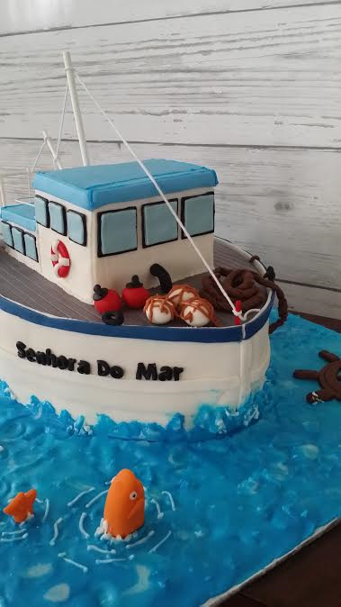 Fishing Boat Cake For A Th Birthday Party A Slice Of Cake Is - Fishing boat birthday cake