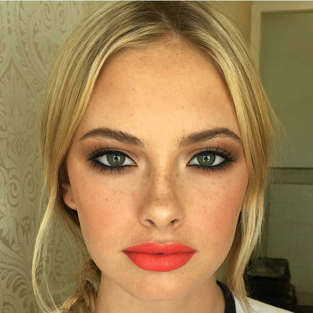 Perfect look for a spring wedding. Loving the orange lips