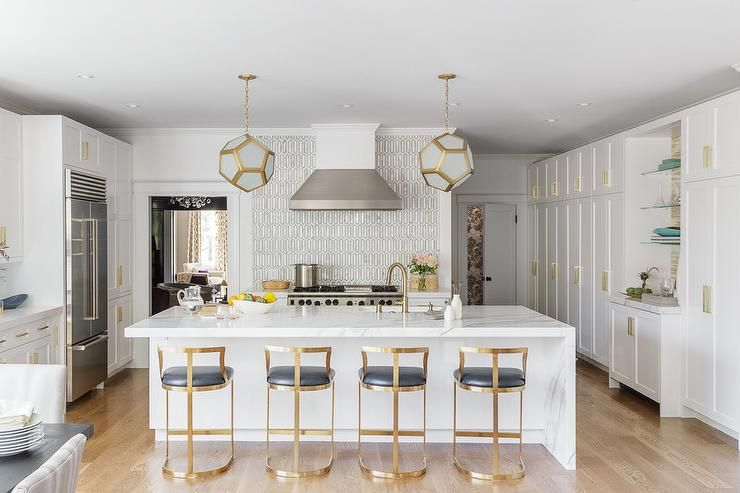 Four Wisteria Emerson Counter Stools Sit In Front Of A White