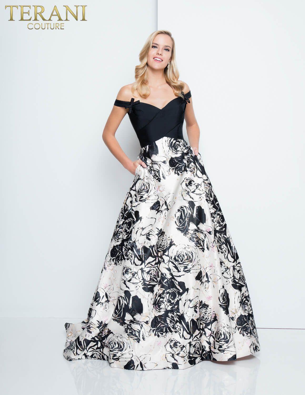 8584da5779d Sweetheart neckline off shoulder gown. Features floral print Mikado skirt.