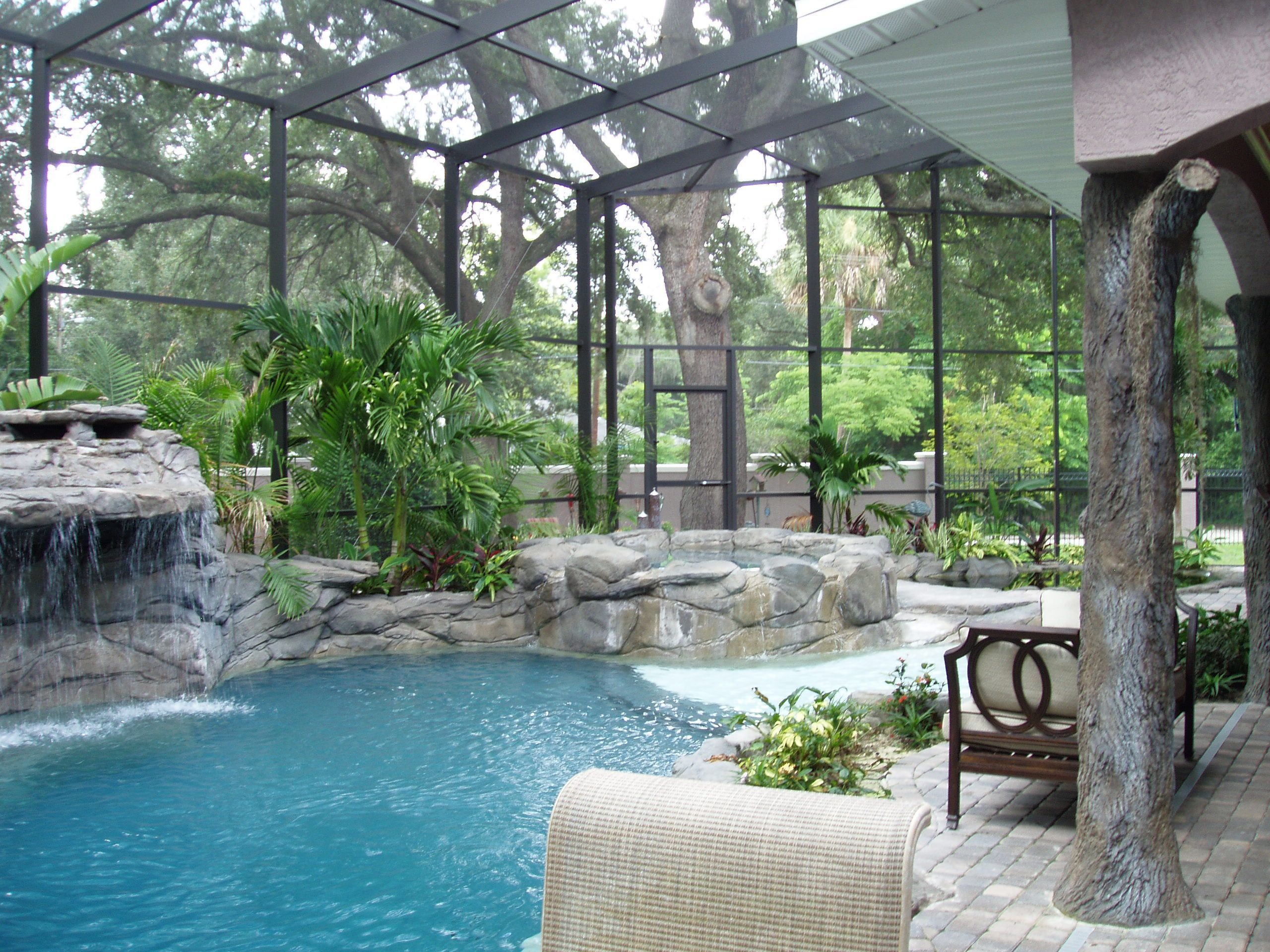 Beach Entry Pool Faux Log Lanai Post And Waterfall With Rock Spa And Beach Entry All Enclose Indoor Swimming Pool Design Indoor Swimming Pools Beach Entry Pool