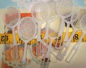 Vintage / Plastic Tennis Racquets / One Dozen / White / Cupcake Toppers. $3.95, via Etsy.