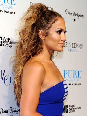 The classic Newyorican look—Jennifer Lopez's half up style—is simple. Apply a light mousse like Garnier Fructis Hydra Recharge Moisture Whip Leave-In Conditioner. Part your hair in half, leaving about an inch strand from the top section out. Pull the top section into a high ponytail, then wrap the remaining strand around it. Lightly spray your hair with your favorite hairspray.