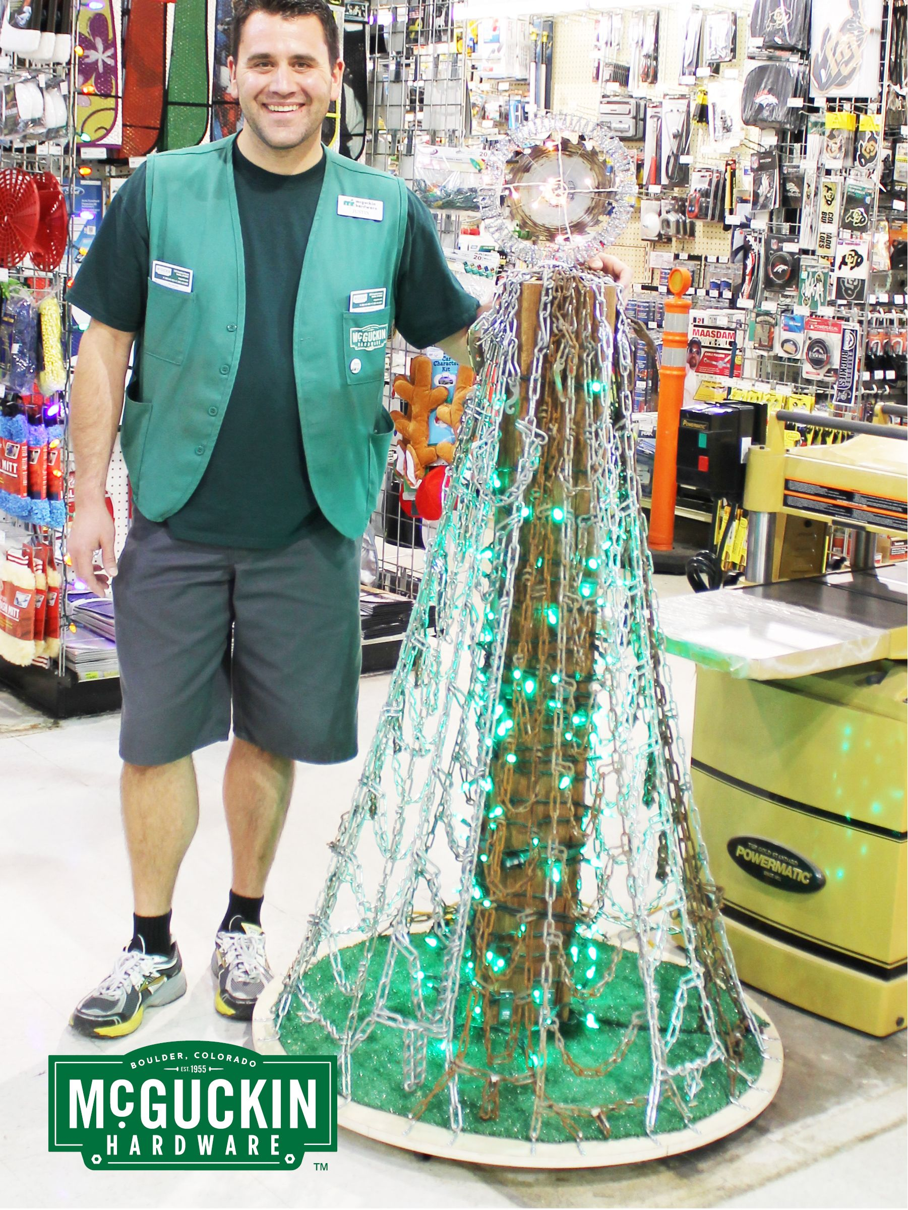 """Our """"Heavy Metal"""" tree is made from old tire chains, an older wood beam, and a used circular saw blade.  www.mguckin.com"""