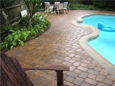 maybe pavers around the pool instead of concrete. | home