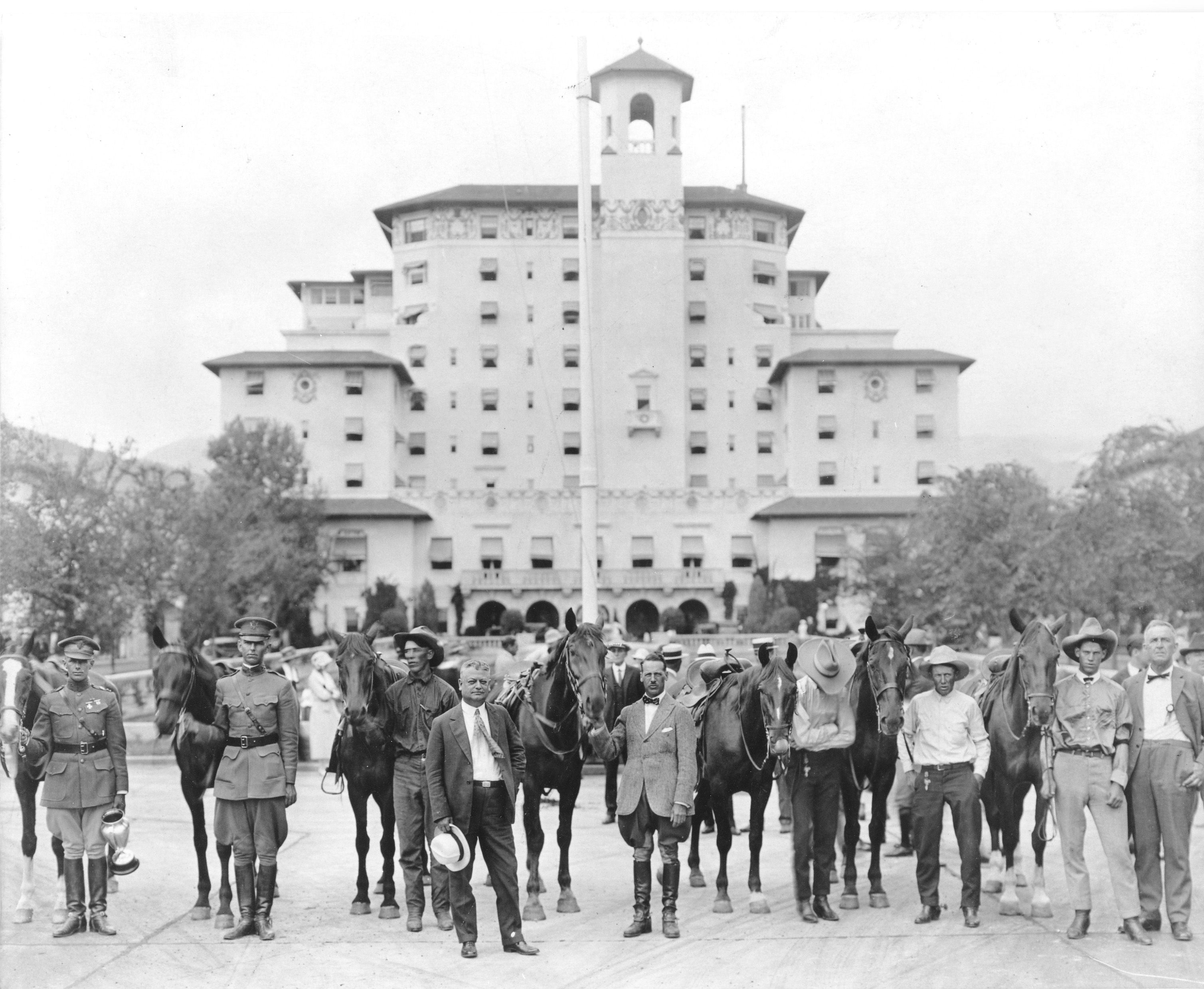 1923 Remount Ceremony with men and horses in front of Broadmoor Main