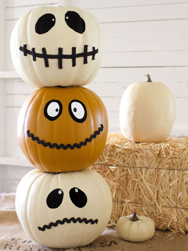 How to Make a Halloween Jack-O'-Totem: Add some personality to your entry and welcome trick-or-treaters with a pumpkin topiary in the shape of a totem pole.  #Halloween #crafts #pumpkin
