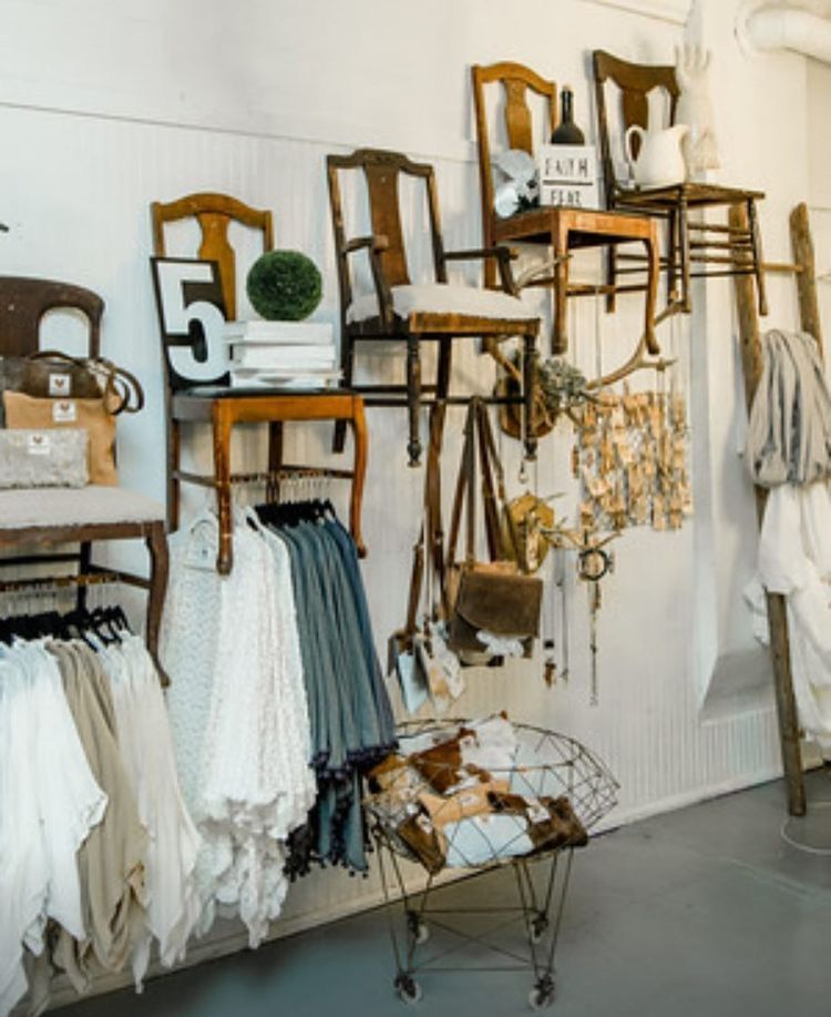 Chairs as clothing rods. Obviously a SHOP but overall a good idea if you have the space ....