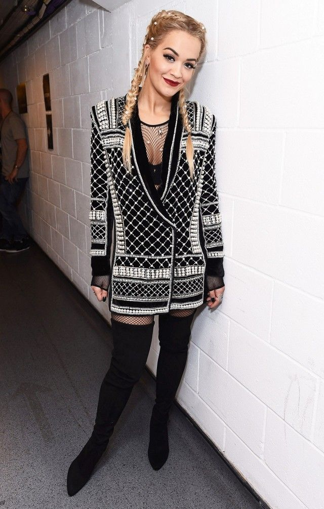 7ef37afa16d Rita Ora wears an H M x Balmain dress with a fishnet bodysuit and thigh-high
