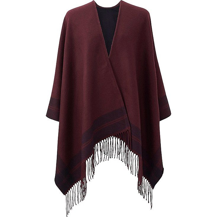 0acc458420499 This thick, warm stole can be wrapped around your arms or thrown over your  shoulders. The double-layer, reversible design features stripes and a  fringe ...