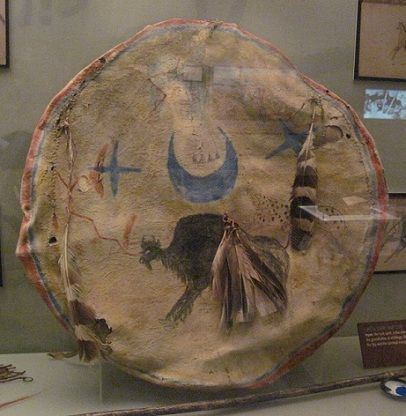 1876 Lakota War Shield - This design is indicative to the Heyoka. The buffalo at central place and the moon and stars show that the warrior has the Thunder Being spirit within him.
