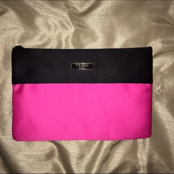 Prada Pink Makeup Bag / Clutch Received as a gift with perfume purchase. NEVER USED!! In excellent, brand new condition. No stains or defects or signs of wear. It's about 8 inches in length and 5 inches in width. Made of polyester but it's super soft. NO TRADES!! Prada Bags Clutches & Wristlets