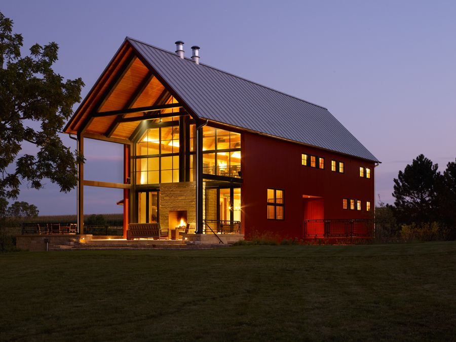 pole barn with covered porch and fire