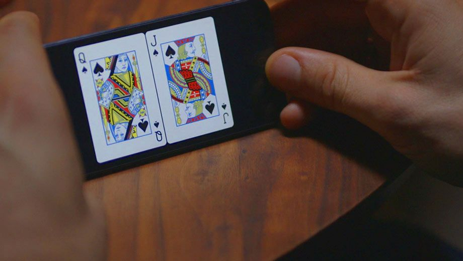 Bold Poker replaces your deck of cards with iPhones.