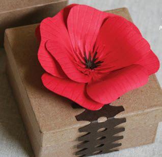 como hacer flores de papel para decorar cajitas de regalo