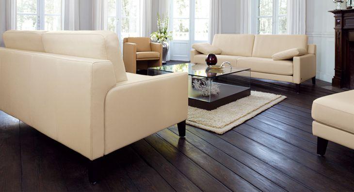 Ivory Color Couches Dark Wooden Floor White Flowers Glass Coffee Table Dark Wooden Floor Dark Wood Floors Modern Room