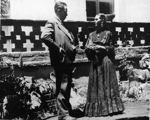Married Mexican painters Diego Rivera (1886 - 1957) and Frida Kahlo (1907 - 1954) talk together in the garden, near the porch of Kahlo's home, Mexico City, Mexico, 1937.