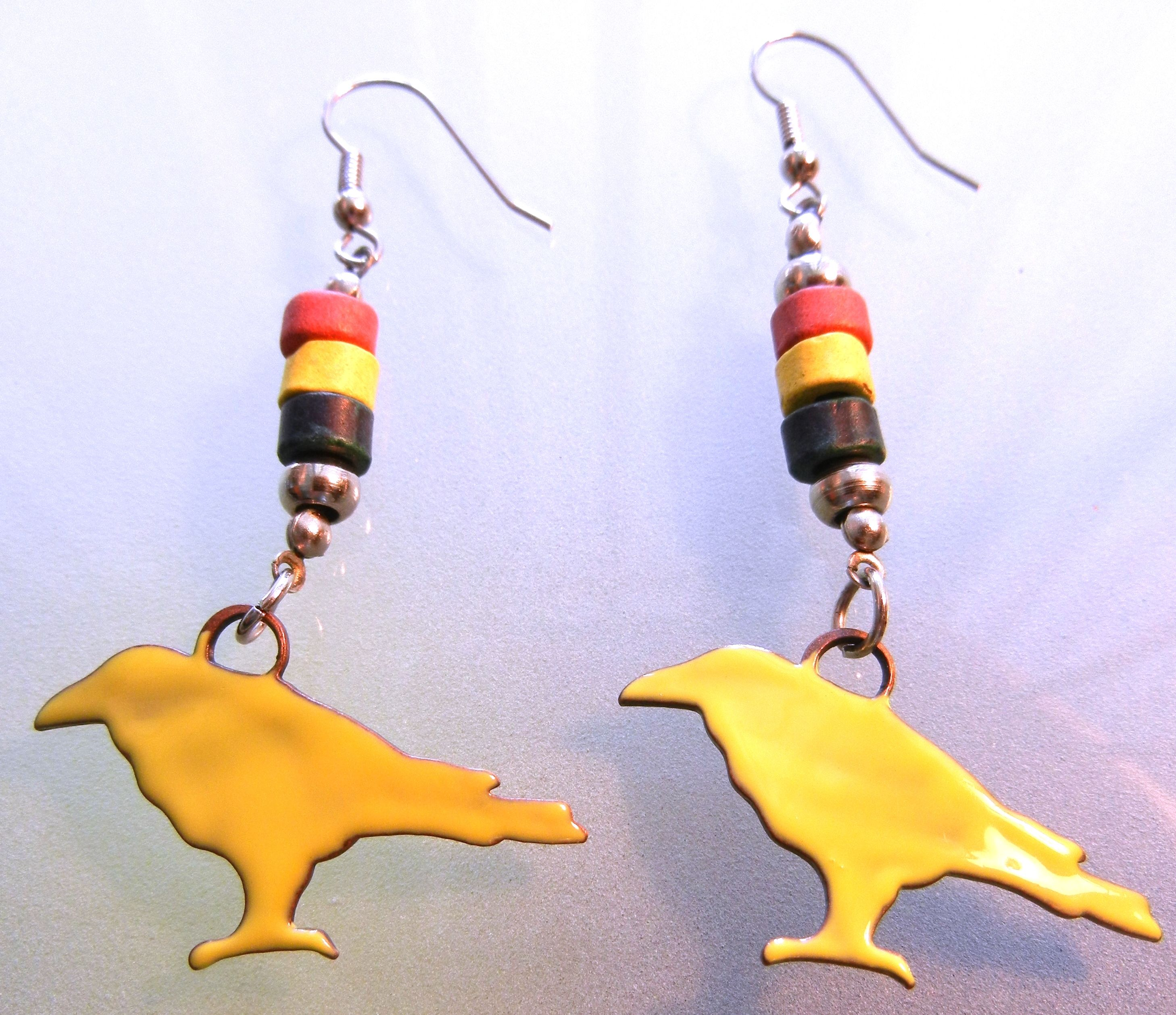 Yellow enamel bird earrings (Again, you find the most interesting objects at Michael's. I got bored of the steel peace signs originally dangling from these earrings so I substituted something more my style.)