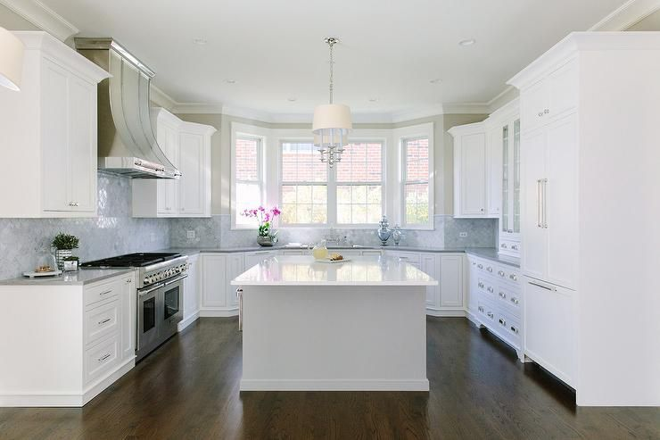 Welcoming U Shaped Kitchen Boasts A Bay Window Positioned Above A Sink Paired Wit Kitchen Remodel Countertops Cheap Kitchen Remodel Kitchen Remodeling Projects