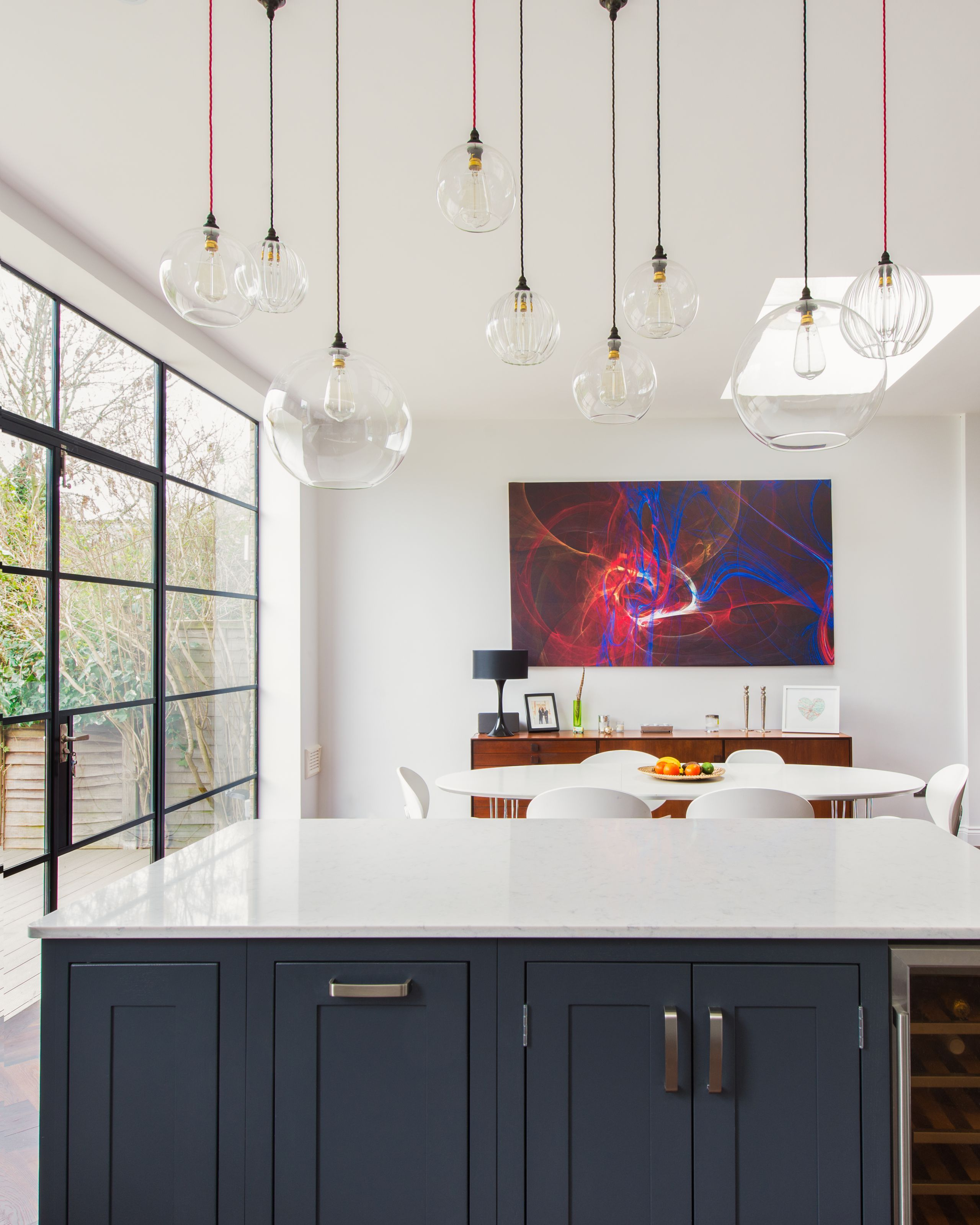 Positioning pendant lighting above a kitchen island is an easy ...