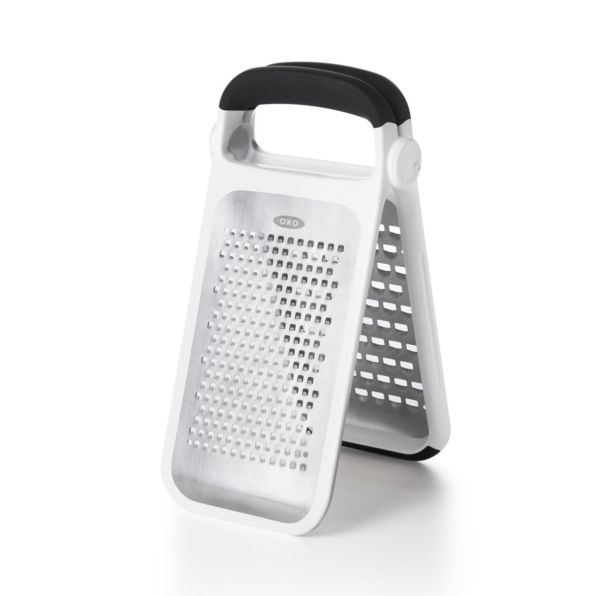 Two tools in one allow you to grate hard and soft cheeses  chocolate  potatoes  onions and more. The OXO Good Grips Etched Two-Fold Grater has extra-sharp  etched stainless steel grating surfaces that stand upright together over a cutting board or detach for use over a bowl. Coarse and medium grating patterns give you different options. The soft handle provides a comfortable grip  while non-slip feet stabilize the grater as you work. Two convenient  snap-on covers protect your hands and the grat