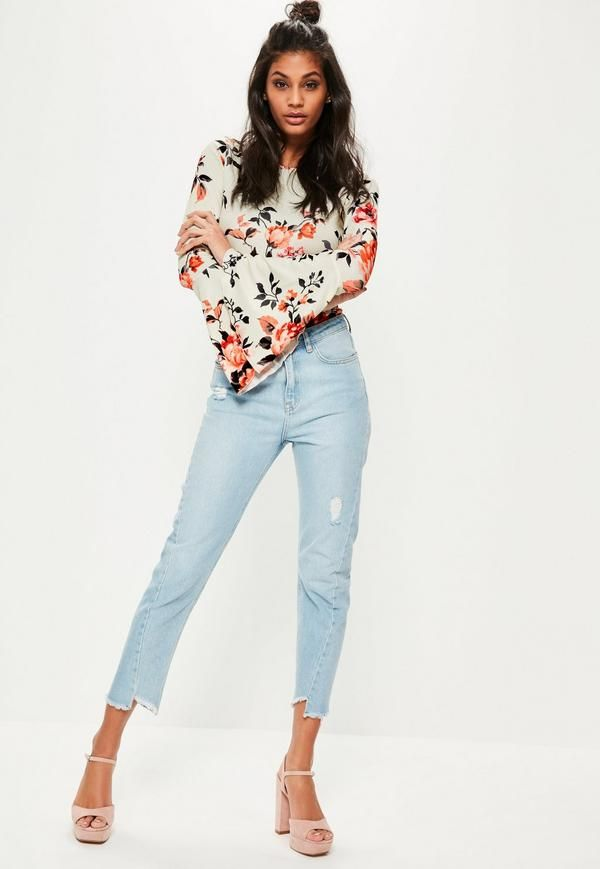 40a299fc3a Install some flower power into your new season game in this long sleeve  bodysuit with its light floral print and flared sleeves.