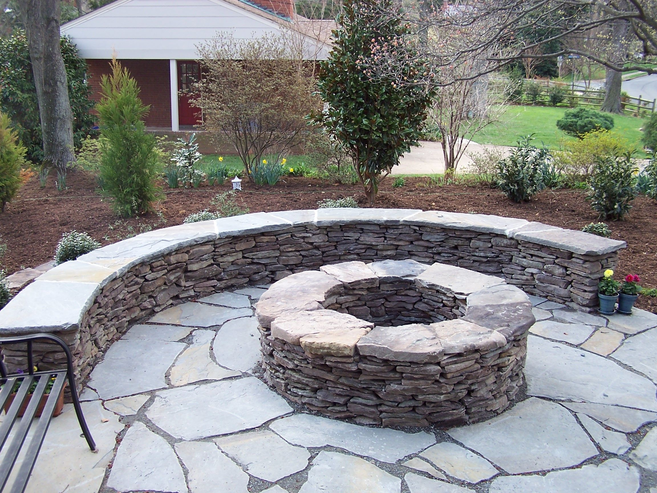 Firepit This Uniquely Shaped Brick Veneered Fire Pit In Philomont Va Fire Pit Landscaping Garden Fire Pit Outdoor Fire