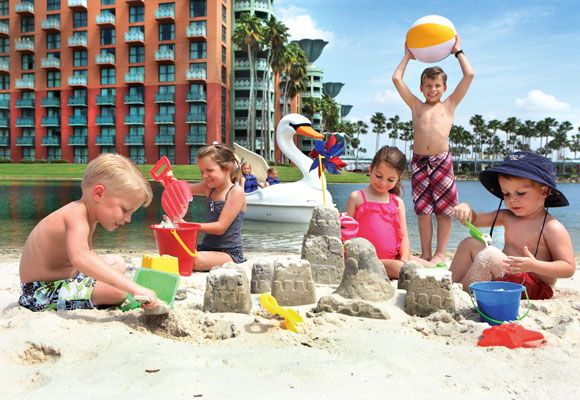 "Walt Disney World Swan and Dolphin Resort near Orlando earned a spot on ConventionSouth magazine's 2014 list of ""South's Top Resorts for Groups - Family Friendly Category"" {Pictured here: Creative kids having fun on the white sand beach at the Walt Disney World Swan and Dolphin located at Walt Disney World, Florida.]"