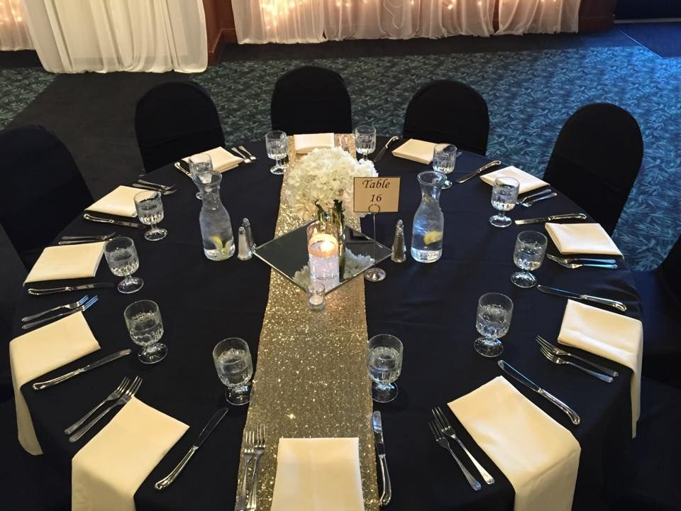Black Linen And Ivory Napkins Draped Over The Table Edge