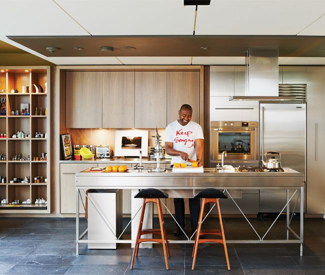 Dentist Kenneth Montague's kitchen workbench by Bulthaup is surrounded by walnut millwork designed by David Peterson and built by Richard Turner.