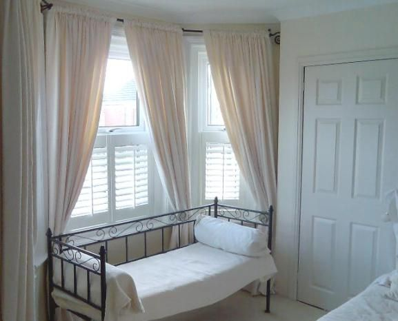 Cafe Style Shutters With A Nice Light Curtain Interior