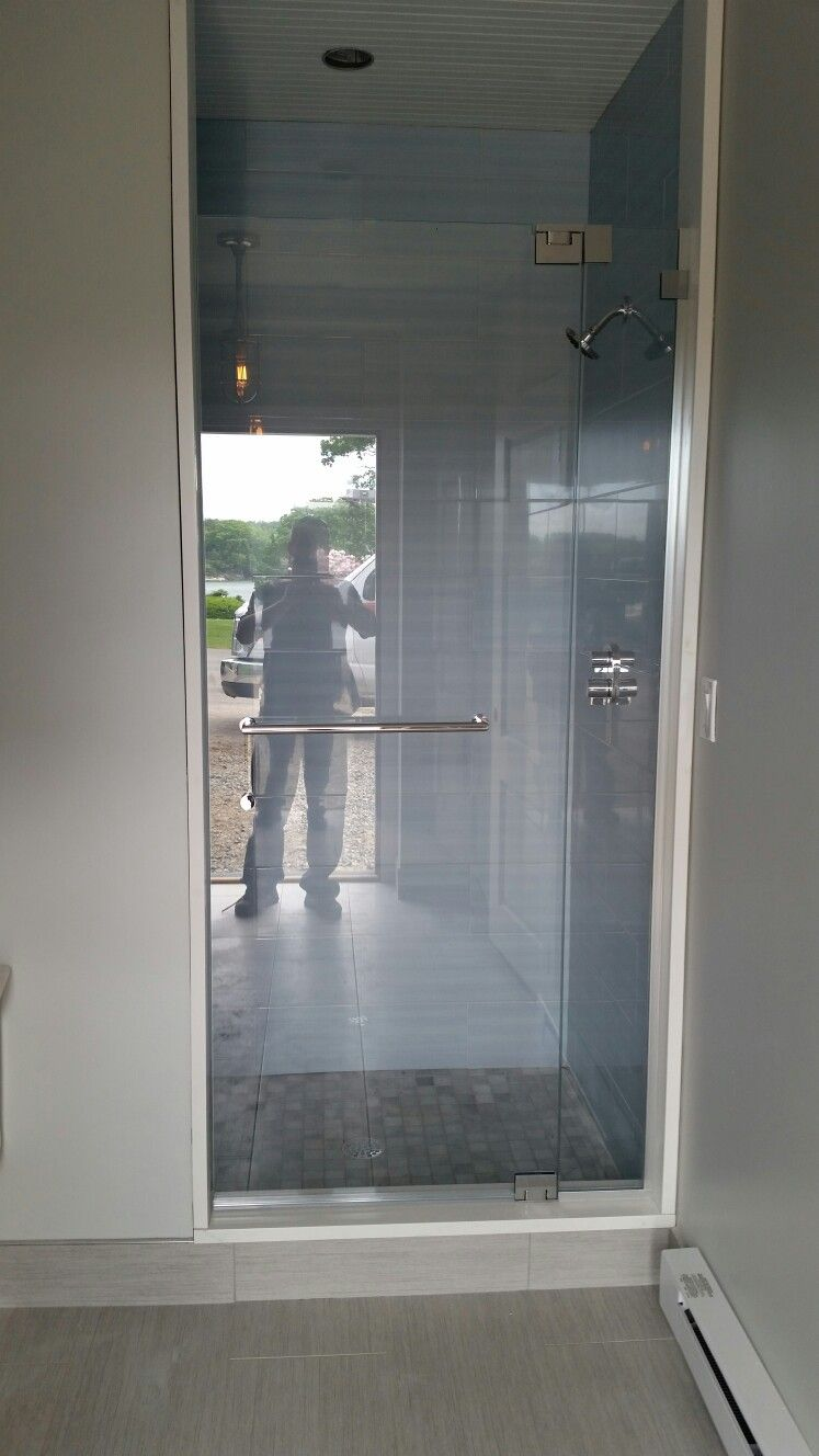 Frameless shower door off fixed panel with no header and 1/2 ...