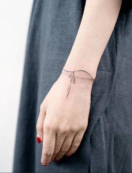 418626818 Wrist ribbon tattoo | Tattoo's | 100 tattoo, Tattoo bracelet, Arm ...