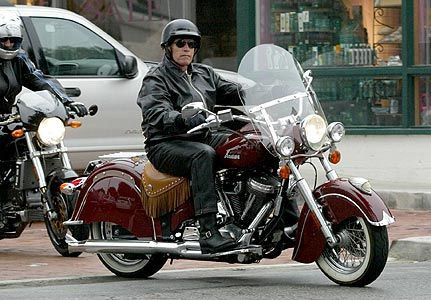arnold schwarzenegger leads the pack as he rides with motorbike