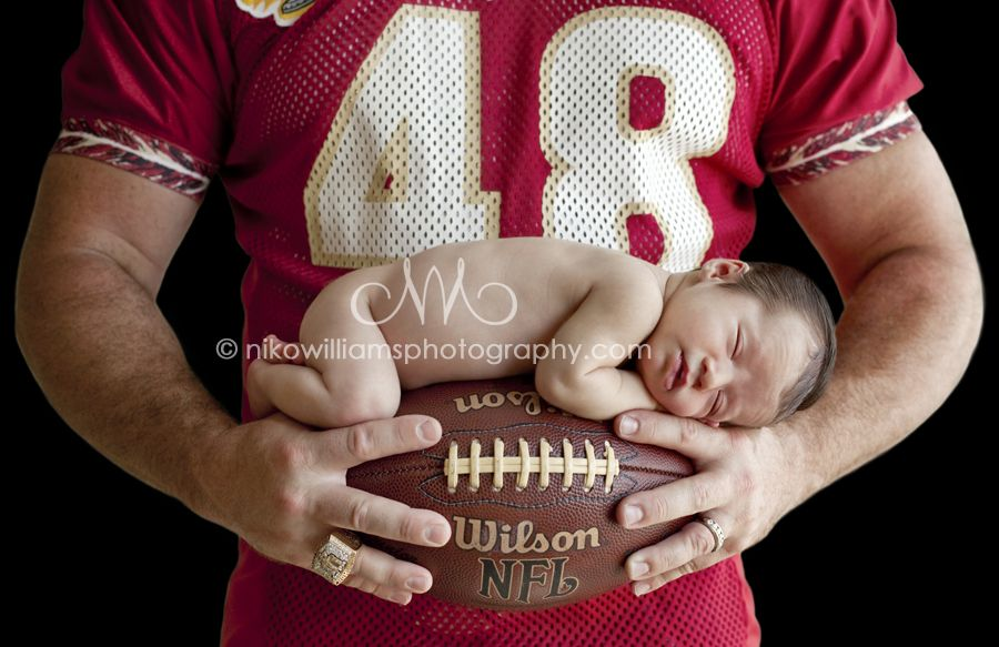 Dad with jersey and baby on football
