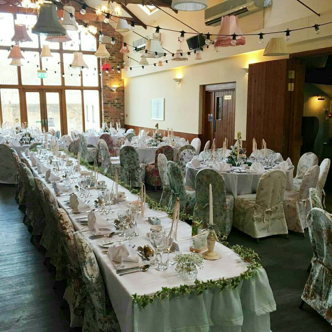 Our Vintage Floral Wedding Chair Covers In Action At A Pretty Vintage Wedding At The Hall Farm Hotel And R Chair Cover Hire Chair Covers Wedding Wedding Chairs