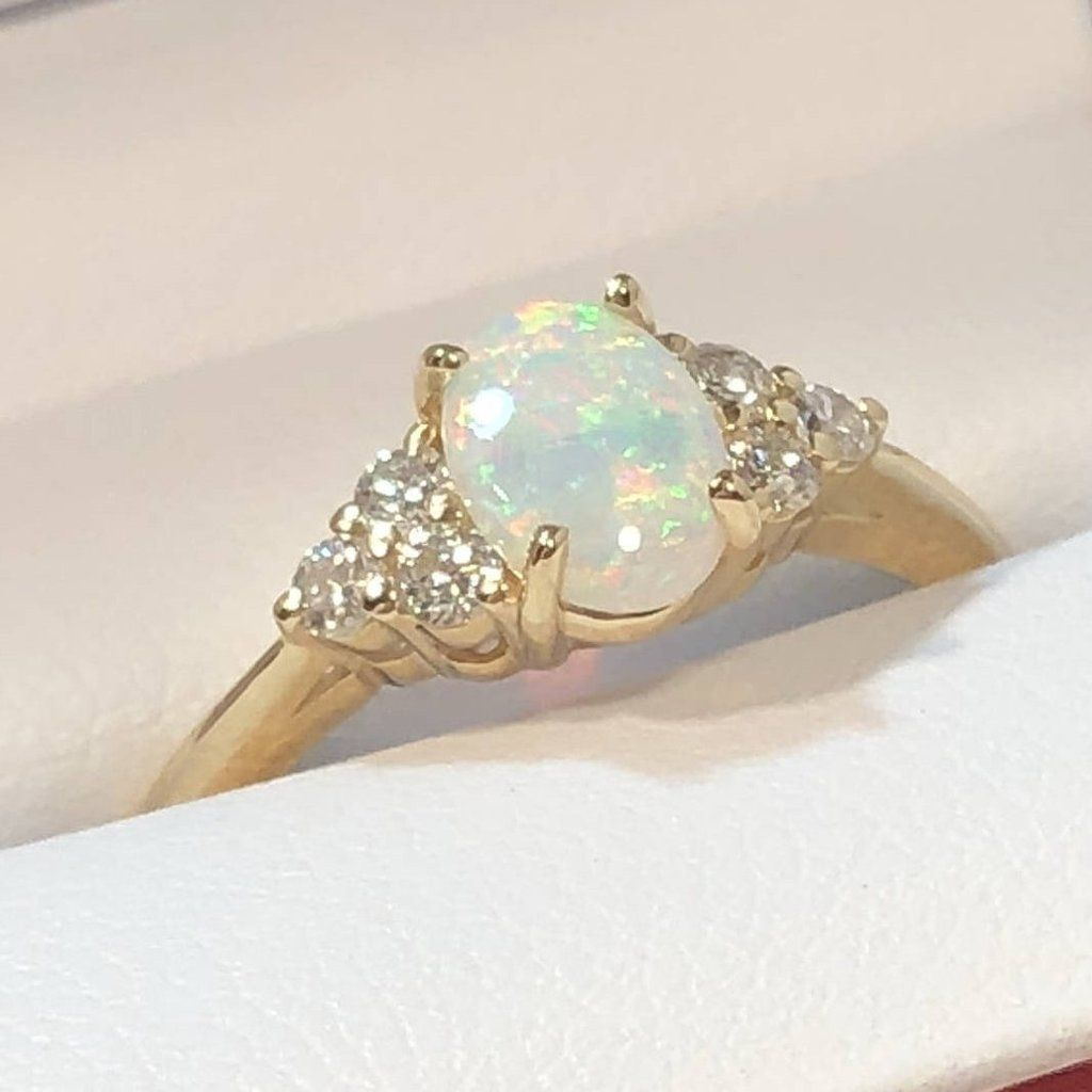 Gold diamond opal ring with images engagement rings
